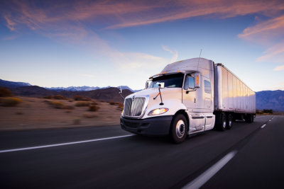 Portrait of Truck and Highway at Sunset
